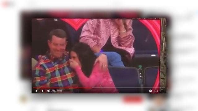 The Swinneys on kiss cam (Source: YouTube)