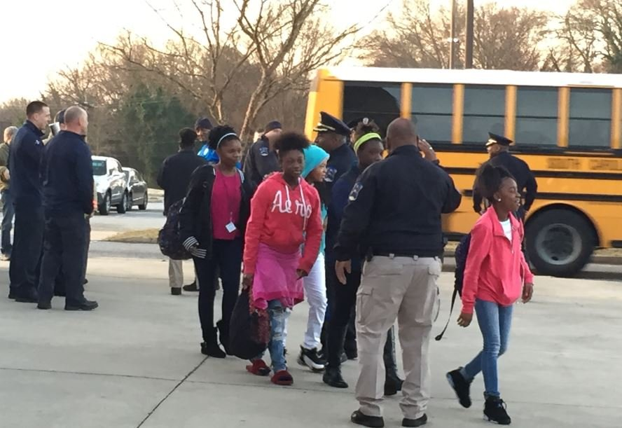 Police and firefighters greet students at Carver Junior High (FOX Carolina/ Feb. 9, 2018)