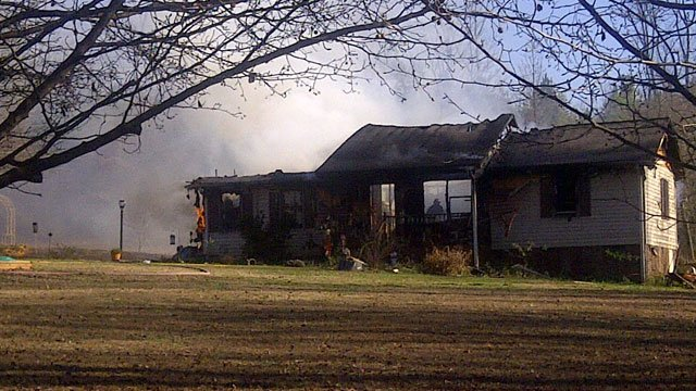 Flames and smoke rise from an Inman home. (Nov. 23, 2011/FOX Carolina)