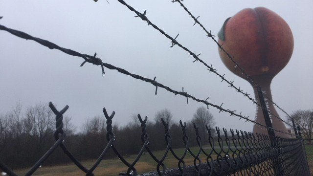 Barbed-wire fence around Peachoid (Feb. 19, 2018/FOX Carolina)