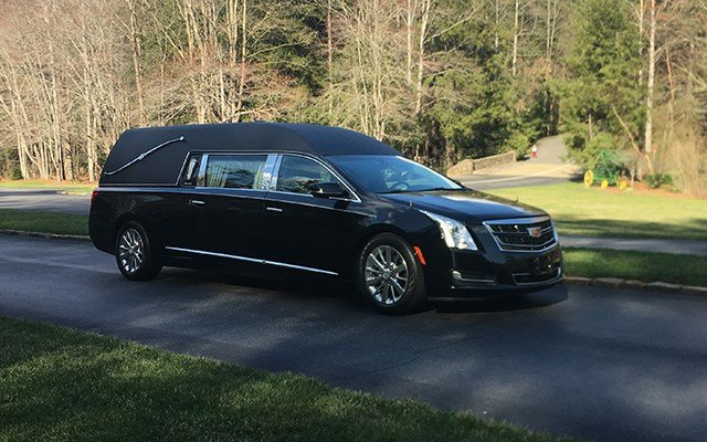Billy Graham's body makes four-hour processional from Ashville to Charlotte, pictures