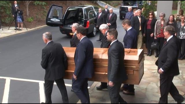 Pallbearers accompany Rev. Graham's casket as motorcade departs (Source: BGEA)