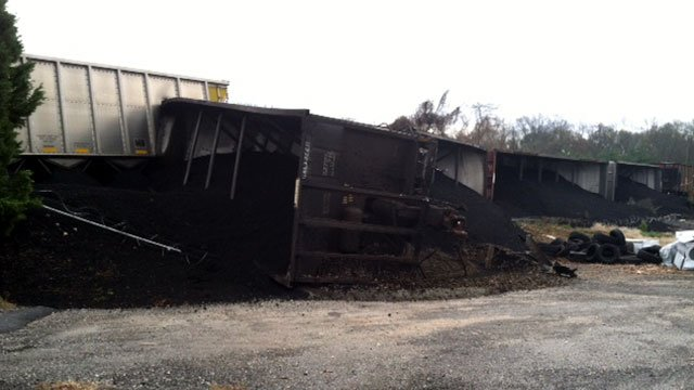 Coal is spilled all over a Spartanburg street after a train derailment. (Dec. 4, 2011/FOX Carolina)