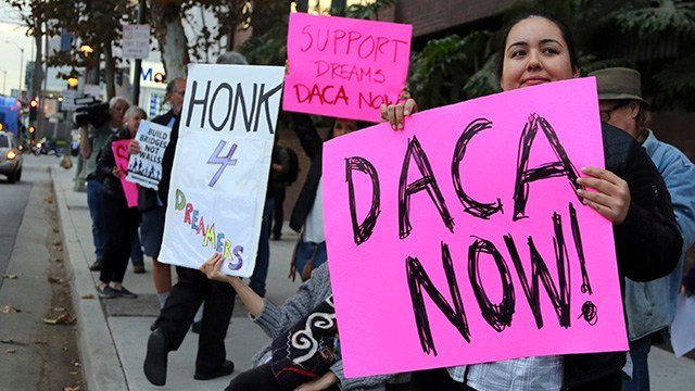 Demonstrators urging the Democratic Party to protect the Deferred Action for Childhood Arrivals Act (DACA). (Source: AP Images)
