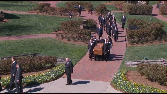 Pallbearers carry Graham's casket (Pool)