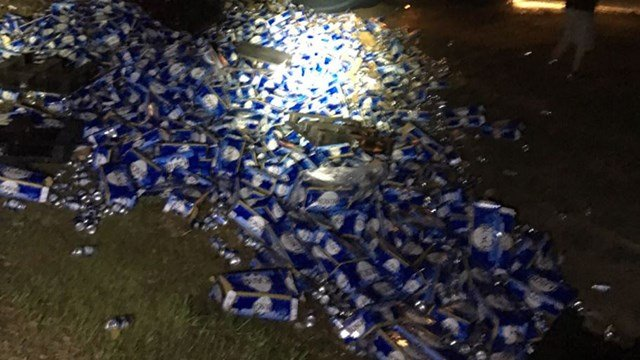 Semi carrying Busch beer spills cargo (Source: Okaloosa Sheriff)