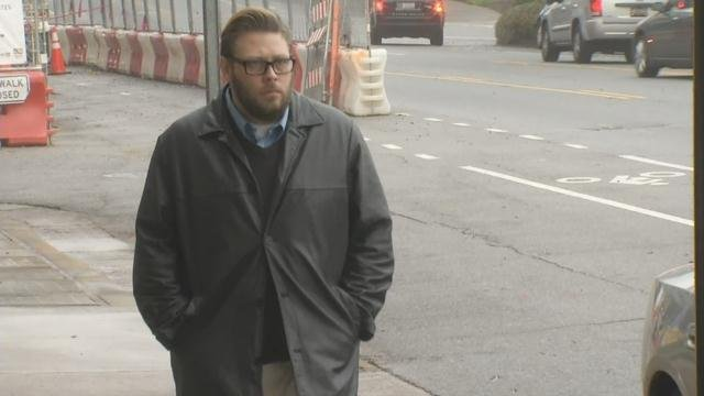 Dustan Lawson walks toward the federal courthouse in downtown Greenville (March 20, 2018/ FOX Carolina)