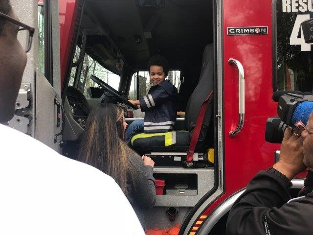 Amari Kalu sits behind the wheel of a fire engine brought to his neighborhood for his birthday (FOX Carolina: 3/20/18).