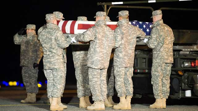 A U.S. Army carry team transfers the remains of Army Pfc. Justin M. Whitmire of Easley, SC, at Dover Air Force Base in Delaware. (Dec. 29, 2011/Department of Defense)