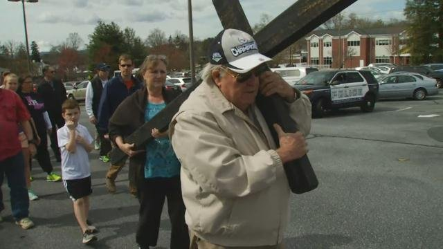 Carrying the cross in Hendersonville, NC.