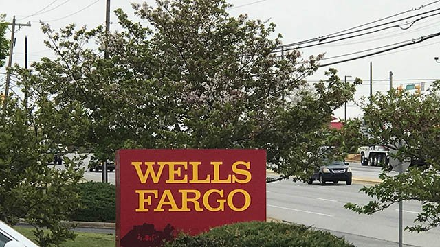 Wells Fargo (NYSE:WFC) Stake Lowered by Community Trust & Investment Co
