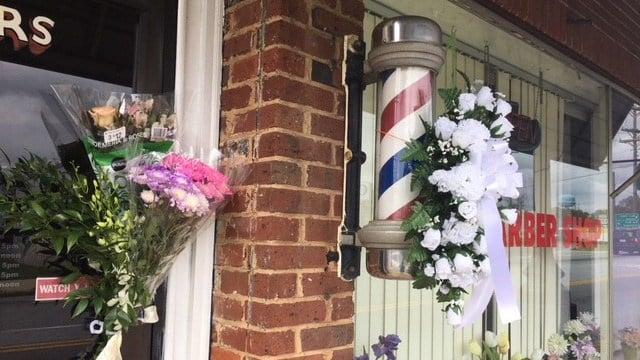 Loved ones bring flowers to where Larue Elizabeth Nalley worked. (4/9/18 FOX Carolina)