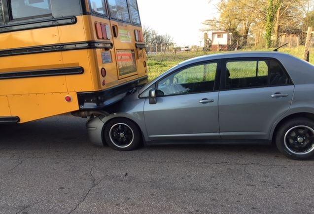 Car wedged under school bus (FOX Carolina/ April 11, 2018)