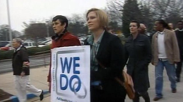 Same sex couples march through downtown Greenville to apply for marriage licenses. (Jan. 17, 2012/FOX Carolina)