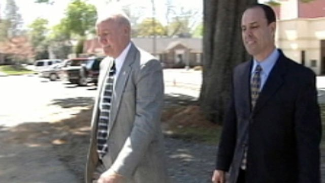 Ex-HomeGold CEO Ronnie Sheppard (right) leaves an Upstate courthouse with an unknown man. (File/FOX Carolina)