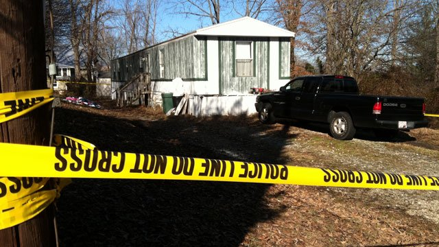 Crime scene tape surrounds a Marion home where authorities said a standoff happened. (Jan. 24, 2012/FOX Carolina)