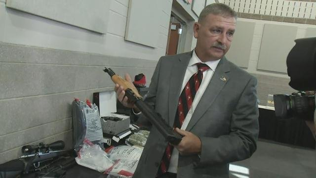 Sheriff Chuck Wright holds a gun seized in Operation Rolling Thunder (FOX Carolina/ May 4, 2018)