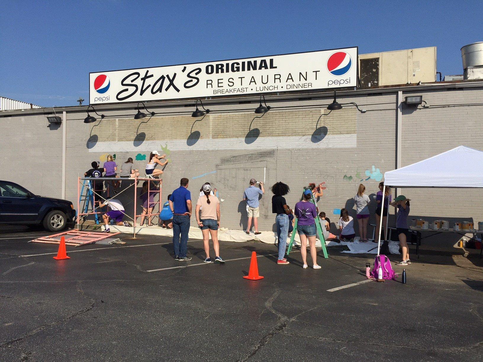 Furman University students paint community mural on Stax's Original Restaurant (FOX Carolina/May 10, 2018)