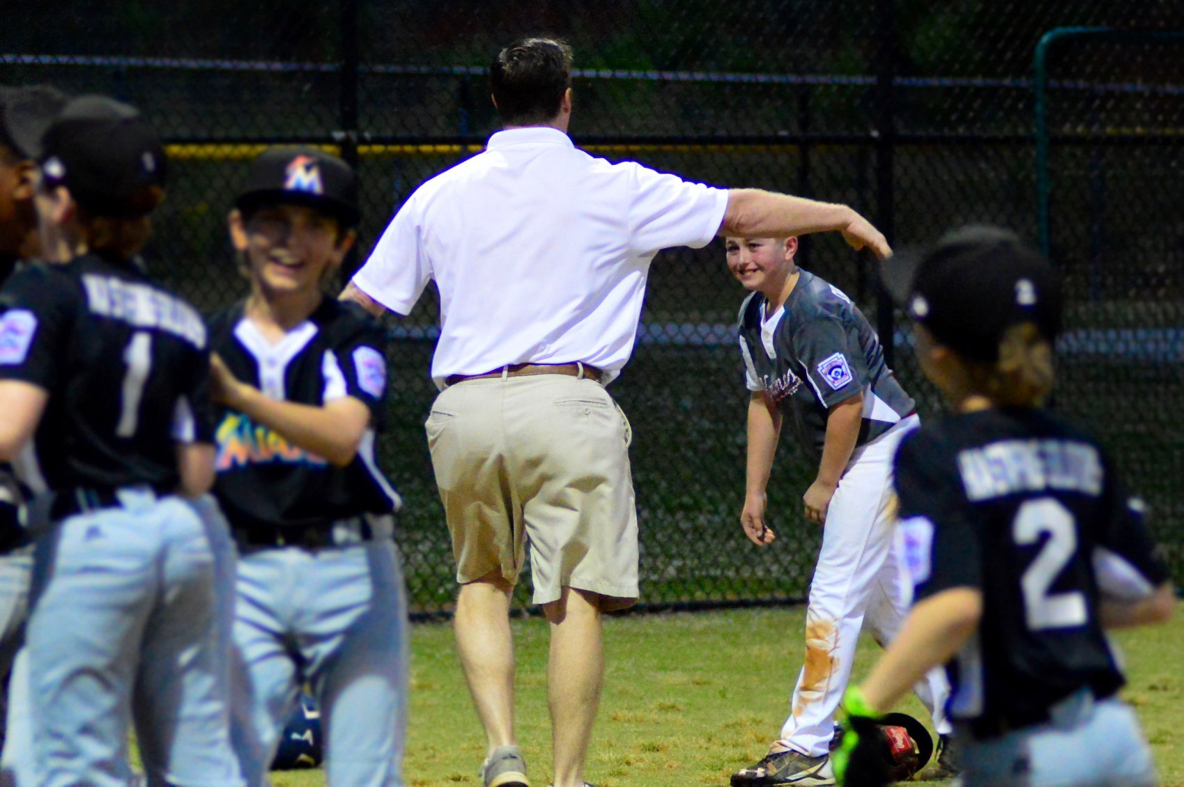 Ethan Hynicka hugs Coach Dawsey of the opposing team (Source: Northwood Little League)