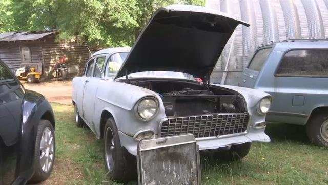 Deputies: Motorcyclist threw hammer through grill of classic car on the roadway