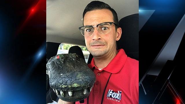 Brandon LaVorgna with the alligator decoy (June 1, 2018/FOX Carolina)