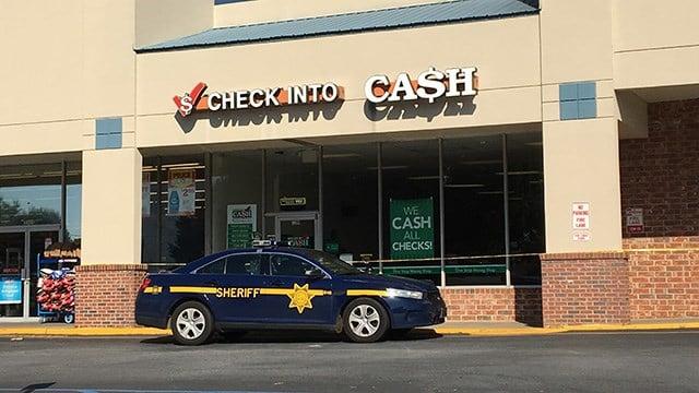 Scene at Check Into Cash on West Blue Ridge Dr. (6/4/18 FOX Carolina)