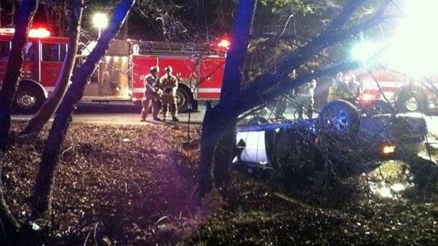 Firefighters look over the scene of a fatal crash near Simpsonville. (Feb. 10, 2012/FOX Carolina)