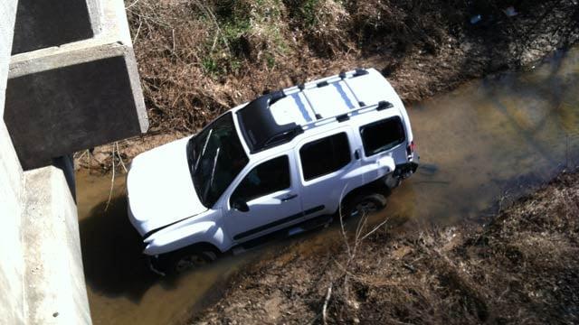 The SUV in a creek off of US 76 near Tri-County Technical College. (Feb. 15, 2012/FOX Carolina)