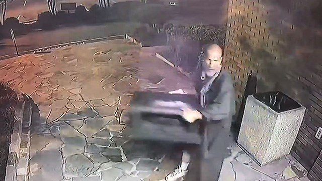 Surveillance footage of suspect smashing into business to steal fake plant, per PD. (Source: GPD)