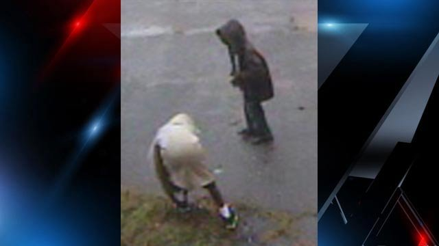 Surveillance photos from the YWCA shows two subjects police say vandalized the Greenville Literacy Center. (Greenville Police Dept.)