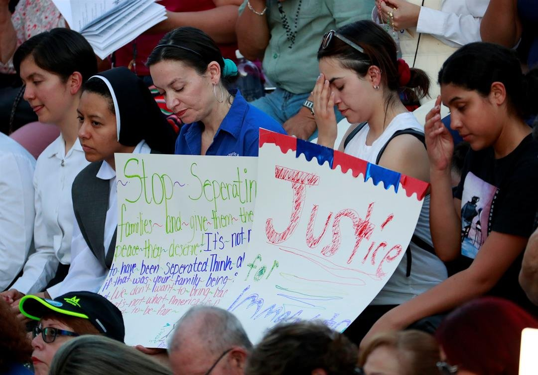 People protest the separation of immigrant families (AP Photo/Matt York)