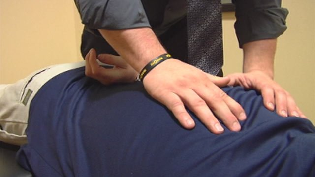 A massage therapist works on a patient receiving therapy. (File/FOX Carolina)