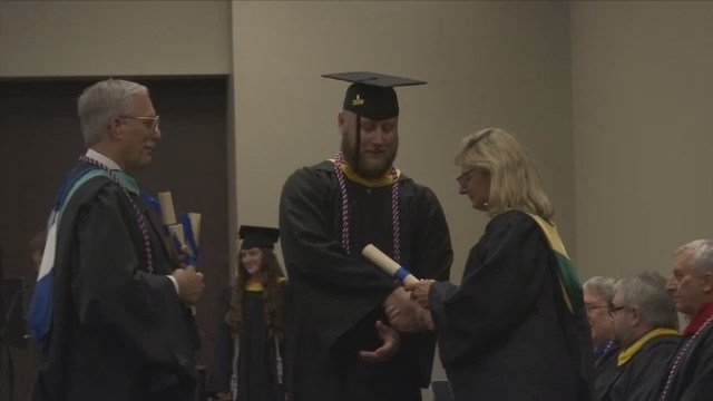 After putting his sister's education above his own, Upstate veteran finally walks across stage