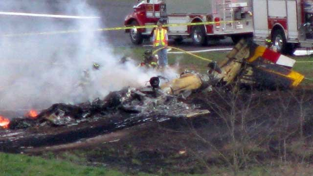 Smoke rises from the smoldering wreckage after a plane crash in Macon County. (March 15, 2012/Scott and Connie Cummings)