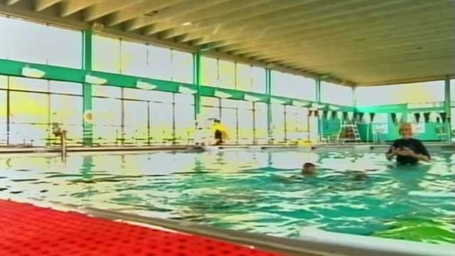 Two children learn to swim at the Spartanburg Swim Center. (March 19, 2012/FOX Carolina)