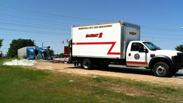 Tractor trailer carrying glue overturns, spills glue on side of road. (April 9, 2012/FOX Carolina)