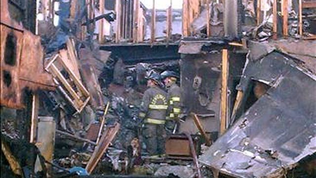 Firefighters inspect the destruction after fire swept through an Anderson apartment building. (April 11, 2012/FOX Carolina iWitness A. Cheek)