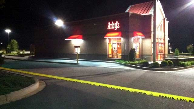 Crime scene tape surrounds an Anderson Arby's restaurant after a robbery. (April 14, 2012/FOX Carolina)