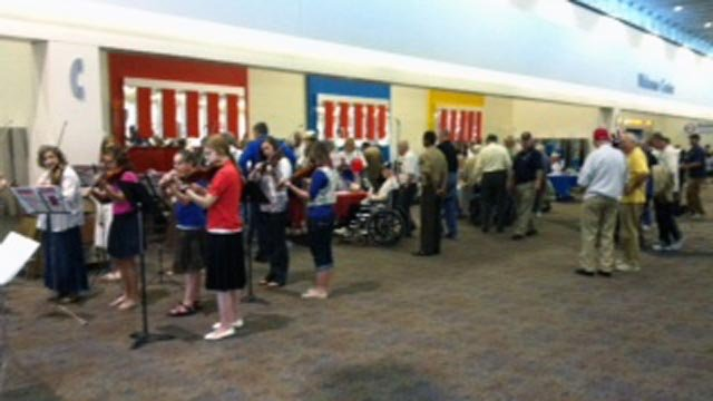 A band performs at Greenville-Spartanburg International Airport as World War II veterans prepare to depart for Washington DC. (April 17, 2012/FOX Carolina)