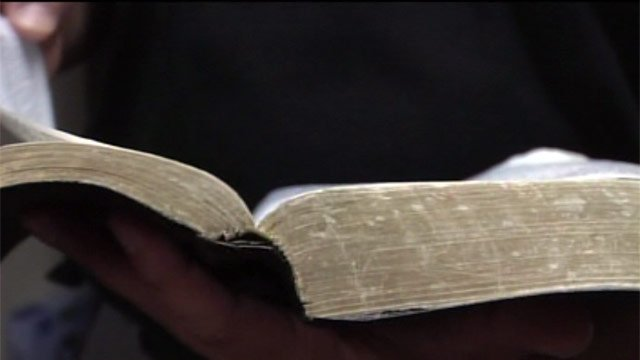 An Upstate pastor reads a Bible. (File/FOX Carolina)