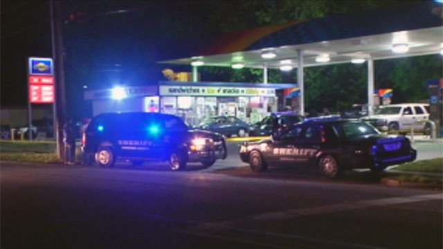 Deputies at the Whitner Street Sunoco after a clerk was shot during a robbery Thursday night. (April 20, 2012/FOX Carolina)