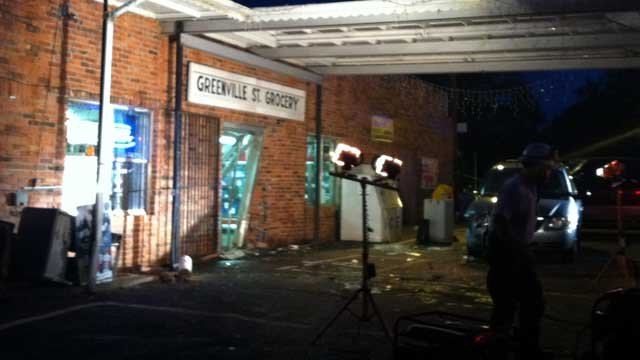 The entrance to Greenville Street Grocery is damaged after a car hit the building. (April 20, 2012/FOX Carolina)