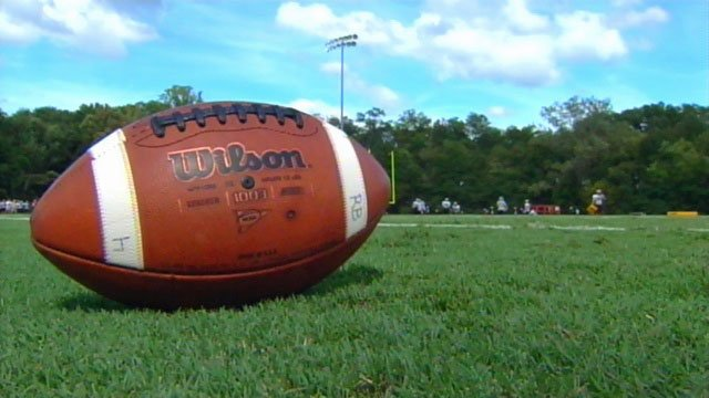 Football players practice for an upcoming game on a field in Spartanburg County. (File/FOX Carolina)