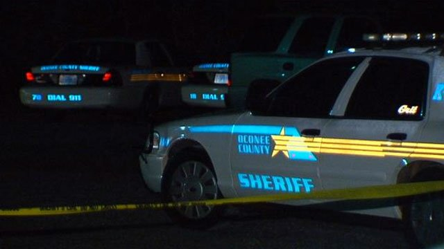 Cruisers from the Oconee County Sheriff's Office are parked at the scene of a standoff. (April 27, 2012/FOX Carolina)