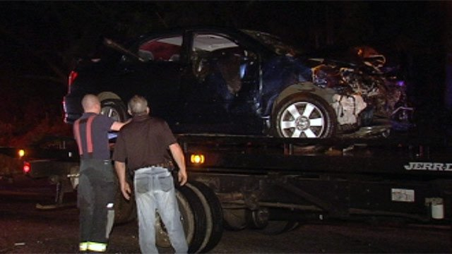 One of the cars involved in the fatal crash along Hickory Nut Road and Hwy 292 is towed away Monday. (April 30, 2012/FOX Carolina)