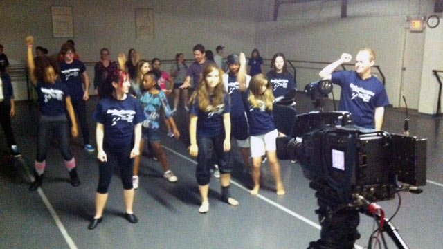 Participants of One Step Stronger learn the dance for Saturday's flash mob. (May 2, 2012/FOX Carolina)