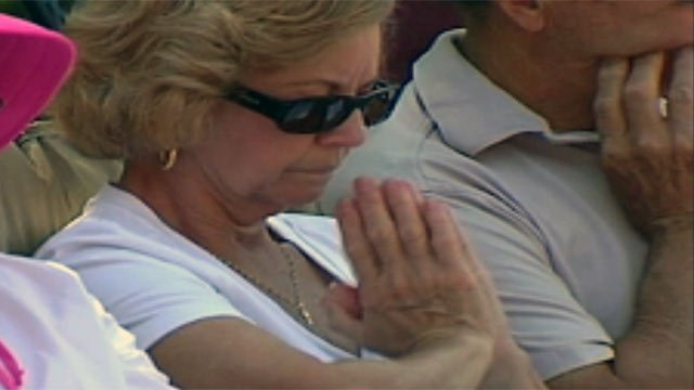 A woman prays at a National Day of Prayer event. (File/FOX Carolina)