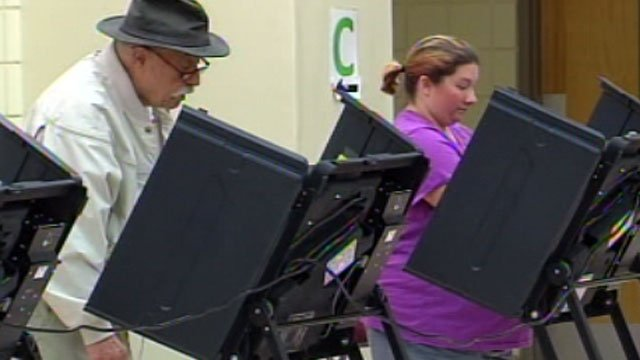 Two North Carolina voters cast their ballots at a Henderson County polling place. (May 8, 2012/FOX Carolina)