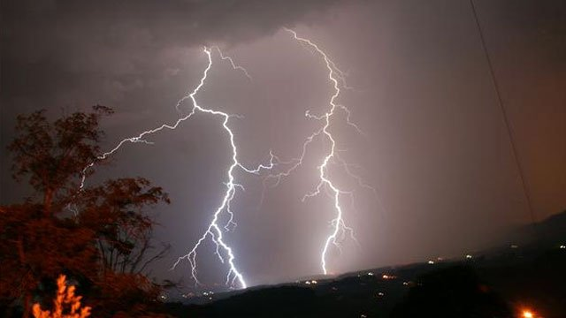 A pair of lighting bolts strike the ground in western North Carolina. (FOX Carolina iWitness masterpriester)