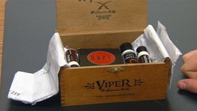 One of Menaji's cigar boxes containing several men's products. (File/FOX Carolina)